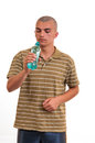 Young man drinking fresh water from bottle portrait of Royalty Free Stock Images
