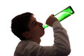 Young man drinks a beer silhouette of on the white background Stock Photo