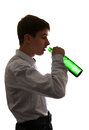 Young man drinks a beer silhouette of on the white background Royalty Free Stock Image