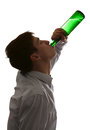 Young man drinks a beer silhouette of on the white background Royalty Free Stock Photo