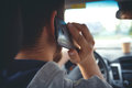 Young man driving a car with phone Royalty Free Stock Photo
