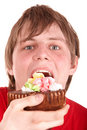 Young man eating chocolate cake. Royalty Free Stock Photo