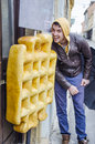 Young man eating enormous artificial waffle set for advertising place Stock Photos