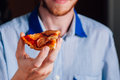 Young man eating pizza margherita with beard Royalty Free Stock Images