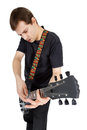 Young man with electric guitar isolated on white background per performer of rock music Stock Photo