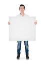 Young man with empty board isolated Royalty Free Stock Images