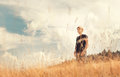 Young man enjoy with tender breeze on golden field Royalty Free Stock Photo