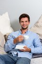 Young man enjoying a coffeebreak Royalty Free Stock Photo