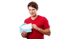 Young man with envelope for your text in red t shirt holding blue here Royalty Free Stock Image