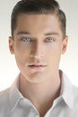 Young man face close up portrait of handsome against neutral background in white shirt Royalty Free Stock Images