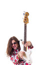 Young man with face expression playing electric bass guitar Stock Photography