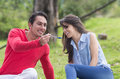 Young man feeding girlfriend with a spoon Royalty Free Stock Photo