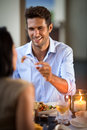 Young man feeding his beautiful girlfriend men try my meal Stock Images