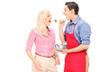 Young man feeding his wife men isolated on white background Stock Photo