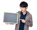 Young man finger point to chalkboard Royalty Free Stock Photo