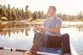 Young Man Fishing From Kayak On Lake Royalty Free Stock Photo