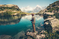 Young Man fishing on Lake with rod mountains landscape on background Royalty Free Stock Photo