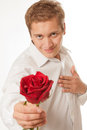 Young man with a flower in her hand isolated on white background Royalty Free Stock Photos