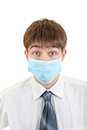 Young man in flu mask surprised isolated on the white background Stock Photos