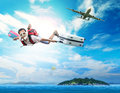 Young man flying on blue sky wearing snorkeling mask and holding Royalty Free Stock Photo