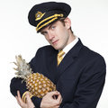 Young man in the form of a passenger plane pilot Royalty Free Stock Photo