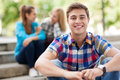 Young man with friends in background Stock Photo