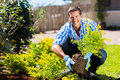 Young man gardening happy in backyard Royalty Free Stock Image