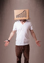 Young man gesturing with a cardboard box on his head with diagra Royalty Free Stock Images