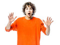 Young man gesturing surprised portrait Royalty Free Stock Photography