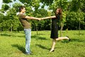 Young man and girl holding for hands outdoor Stock Images