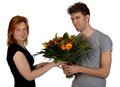 Young man gives his girlfriend flowers Stock Photography