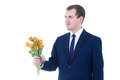 Young man giving bouquet of tulips  isolated on white Royalty Free Stock Photos