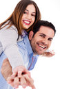 Young man giving piggy back ride to his lover Royalty Free Stock Photo