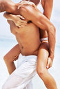 Young man giving piggy back ride to a woman Stock Image