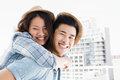 Young man giving a piggyback ride to woman men women outdoors Royalty Free Stock Image