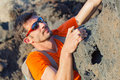 Young man in glasses with backpack climbing Royalty Free Stock Photo