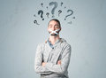 Young man with glued mouth and question mark symbols Royalty Free Stock Photo