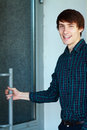 Young man going to enter businessman or student the building Royalty Free Stock Photo