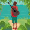 Young man with guitar on the island