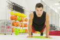 Young man in the gym training Royalty Free Stock Photo