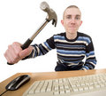 Young man with hammer on hand and keyboard Royalty Free Stock Photo