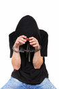 Young man in handcuffs isolated on the white background Stock Images