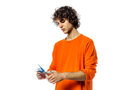 Young man happy holding credit card portrait Stock Photo