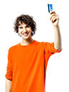 Young man happy holding credit card portrait one caucasian in studio white background Stock Photography