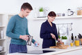 Young man and happy  woman preparing breakfast in their kitchen Royalty Free Stock Photography