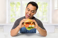 Young Man have a great desire to eat a burger Royalty Free Stock Photo