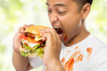 Young man have a great desire to eat a burger portrait of Royalty Free Stock Image