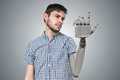 Young man have robotic hand as a replacement for his hand. 3D rendered illustration of hand