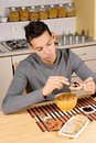 Young man having breakfast Stock Images