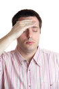 Young man with headache on white Stock Photos